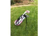 Girls MacGregor golf clubs and golf stand bag