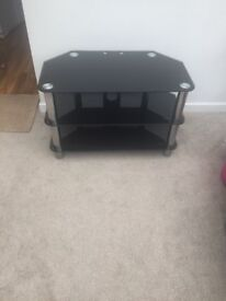 Black tv stand. Very good condition ............,,,,................................................