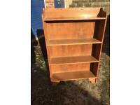 Small solid free standing shelf unit.