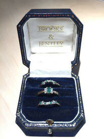 A beautiful wishbone ring with diamonds and emeralds - ideal Valentine's Day Present