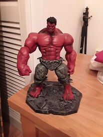 Red hulk toy with stand