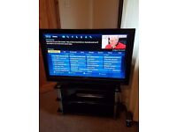 "40"" sony bravia tv HD1080 and black stand"