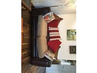 Sofa bed , leather sides and base washable covers and cushions, all extra cushions included. V.g.c.