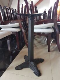 marbleite stone table with cast iron legs