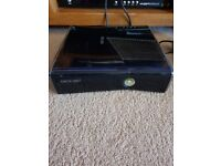 Xbox 360 250GB and 24 games.