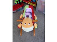 Baby play sit on rocking cow