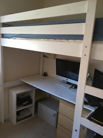 Wood framed high single bed with desk and hanging rail under