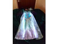 FANCY DRESS - MUSIC AND LIGHTS ELSA COSTUME BY GEORGE SIZE 5-6 YEARS WITH TIARA