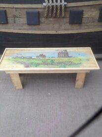 Tynemouth Priory handpainted on a pallet wood coffee table