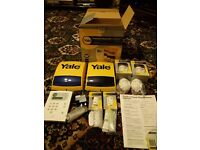 Yale Premium Wireless Alarm Kit HSA6400 with 2 remotes and 4 motion sensors.