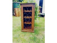 Beautiful wooden wine rack holds up to sixteen bottle of your favourite wine