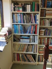 Three white six-shelf bookcases; £10 apiece