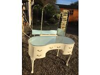 French Louis xv style kidney shaped glass topped dressing table with mirror . Nice solid dresser .