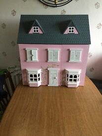 Pink dolls house for sale
