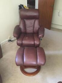 Leather swivel chairs with foot rests