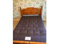 Pine bed frame and open coil spring mattress