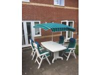 White patio table and chairs with matching parasol