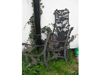 2 flower patterned cast iron bench ends and cast iron chair back