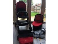 Joie Chrome Pushchair in Red, with carrycot, foot muff and rain covers. Excellent condition.