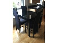 Black gloss table (expandable) & 4 chairs. Excellent condition Collection only.