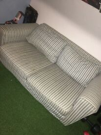 Striped blue and white sofa bed. Smoke free home. Very good condition.