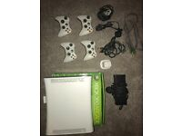 X box 360 arcade with 4 controllers and selection of 11 games