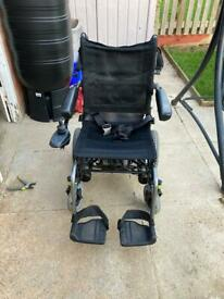 Portable electric wheelchair available for sale