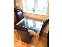 Wooden and glass Table with 4 Leather chairs
