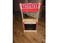 Wooden toy theatre with selection of puppets