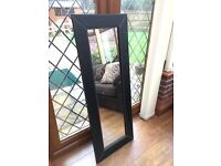 Large black faux leather mirror