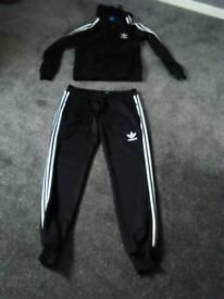 Womens black adidas track suit