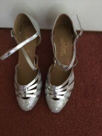 Silver dance shoes,
