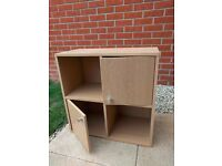 Cupboard storage divided into quadrants with two doors in an oak veneer finish - £10
