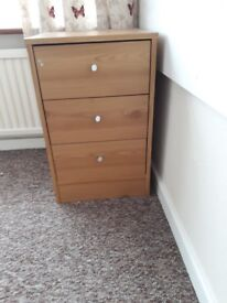 Bedside table with drawers.