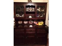 Dark wood living room unit, glass cabinets, draws and plate rack.