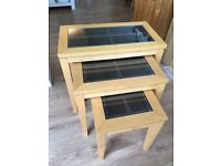 nest of tables - 3 pieces. Light oak colour, leather top tempered glass. Excellent condition