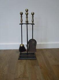 Companion set. Iron with brass colour handles.