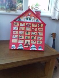 ADVENT CALENDAR IN FORM OF WOODEN HOUSE