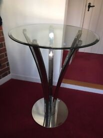 Bistro table with bevelled glass top on curved stainless steel legs. Excellent condition.