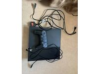 PS4 with controller and charger, HDMI cable and power plug