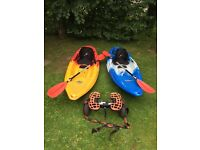 2 Feelfree wheeled Nomad Sport sit on kayaks, with deluxe seats, paddles and wheel transporter.