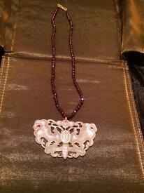 Garnet necklace with jade pendant