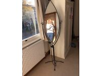 Standing mirror. Very sturdy in good condition with two candle holders attached
