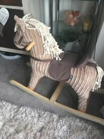 Brand New Rocking horse beautiful and soft brand new . Bargain price of £50 retailed at £169