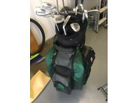Full set of golf clubs including bag and powakaddy trolley