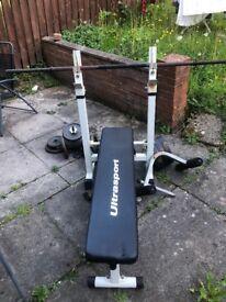 Weight bench + bar bell + dumb bells