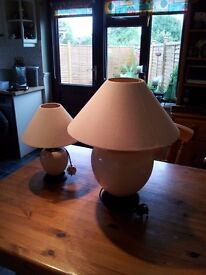 One large lamp and one smaller one sold as a pair