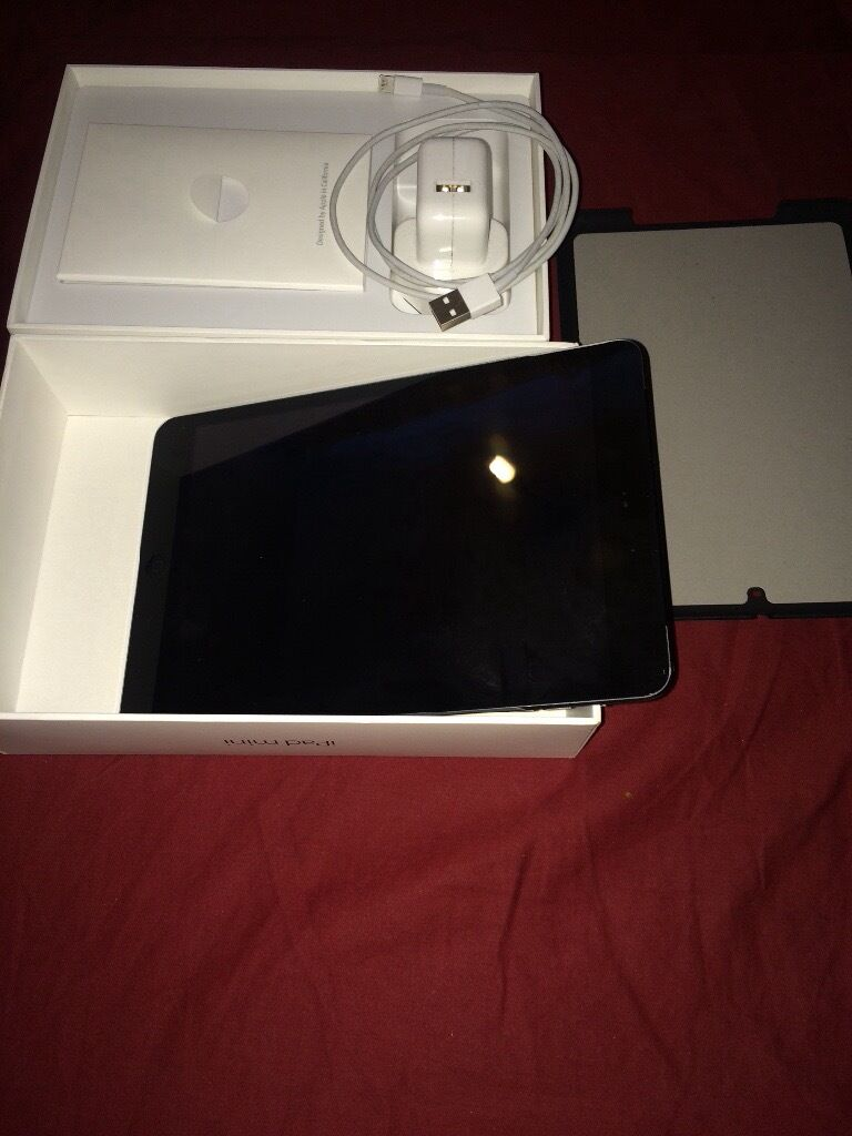 Apple iPad mini 2 space grey 16gb with wifi and 4g only 2 weeks old.