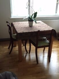 Square dining table that extends to double it's size