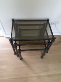 Tables nest of three glass with back legs in good condition, just not needed any longer.